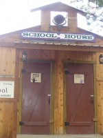 About Bly Books false front schoolhouse at Broken Arrow Crossing